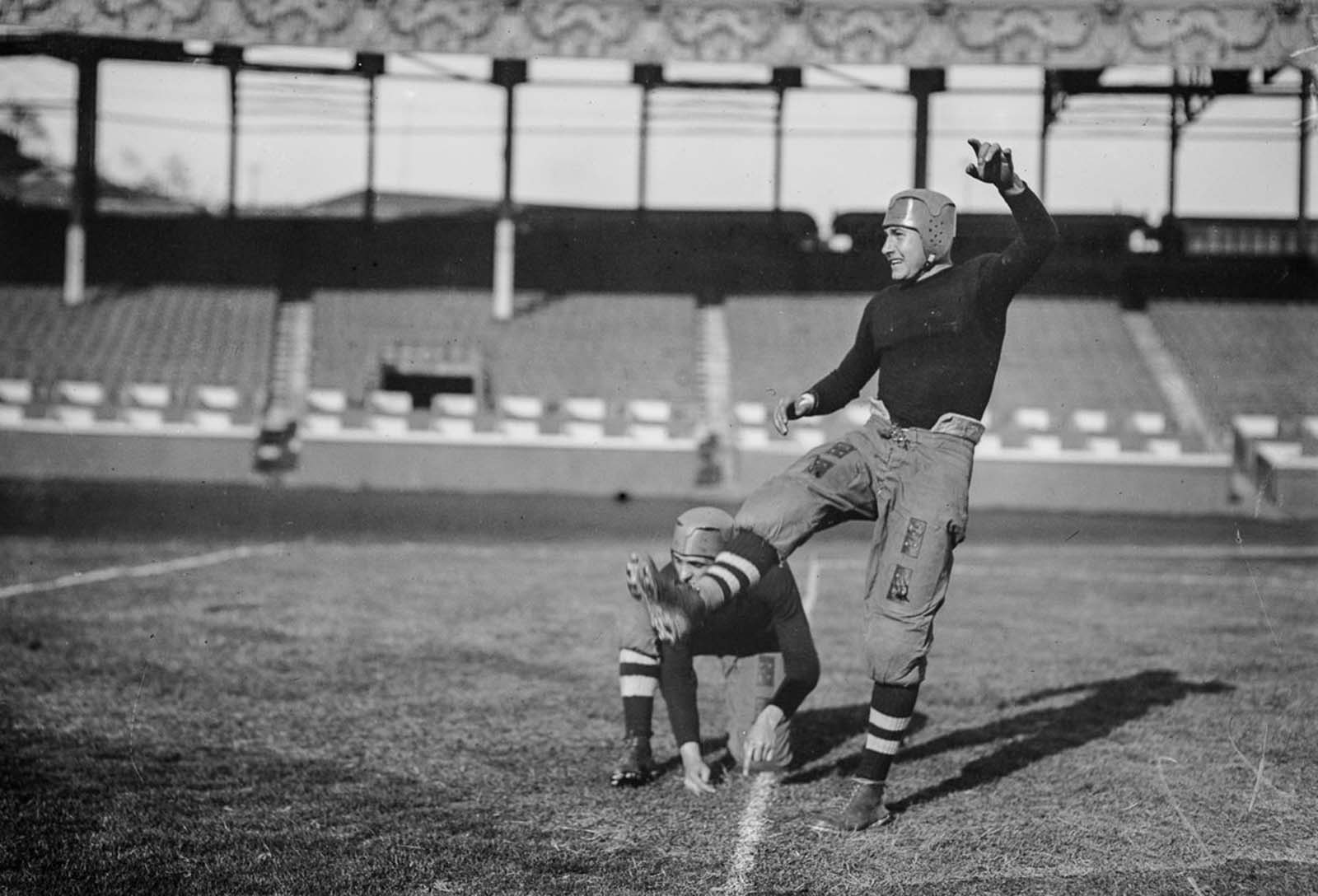 Brown University players compete in a game against Cornell University. 1914.