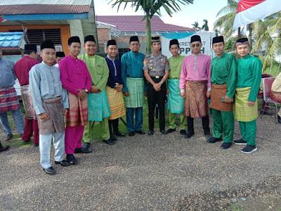 Kapolsek Pengabuhan Dan Ketua Ranting Bhayangkari Hadiri Pelaksanaan kegiatan Upacara Peringatan HUT Provinsi Jambi Ke-63 di Kantor Camat Pengabuan
