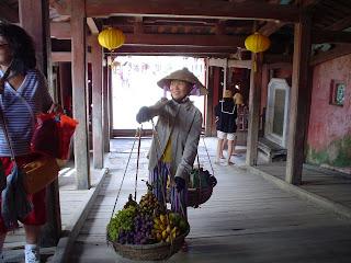 Vietnamese hat peddler with