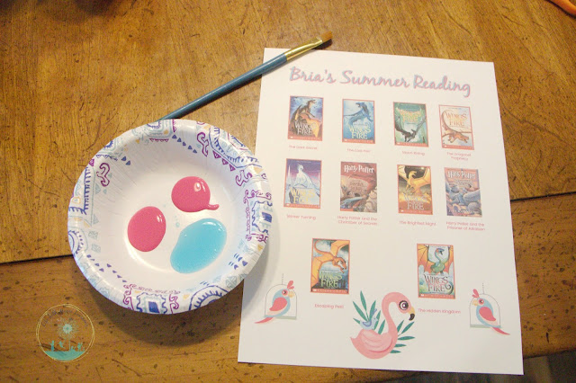 All you need for scratch-off summer reading cards is a printed list, paint, soap, and contact paper.