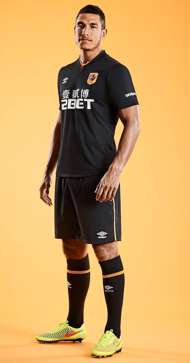 ee0ae28997 The shorts of the new Hull City 2014-2015 Away Kit are black with an orange  line on each side