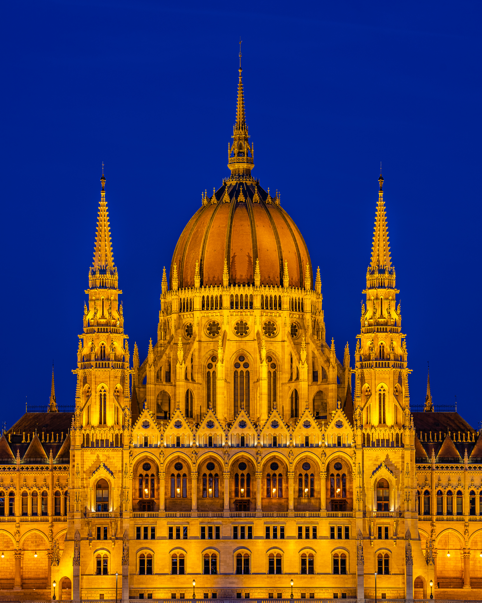 a photo of the hungarian parliament building at dusk in budapest