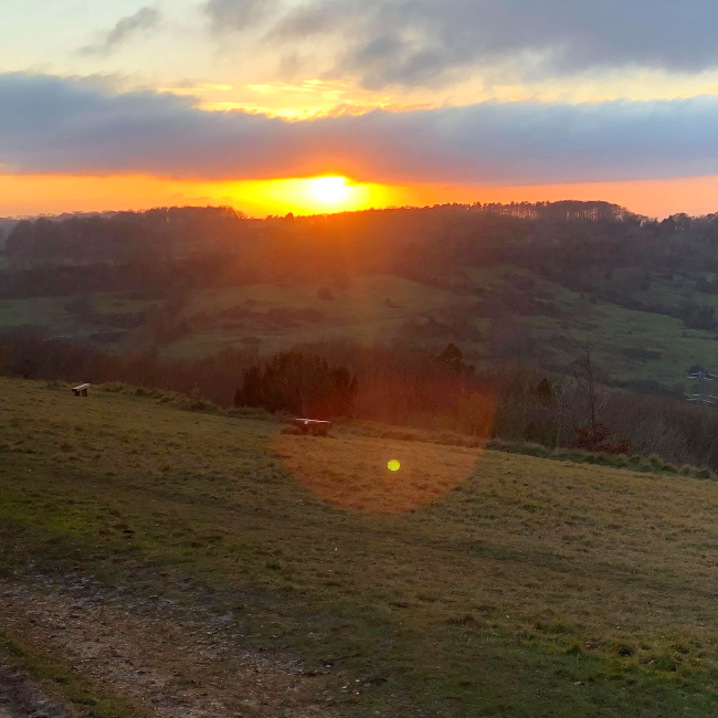Sunset over a hill
