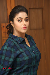 Actress Poorna Stills in Denim Jeans at Jayammu Nischayammu Raa Movie Interview 0004