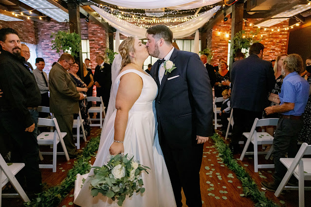 bride and groom kiss after ceremony