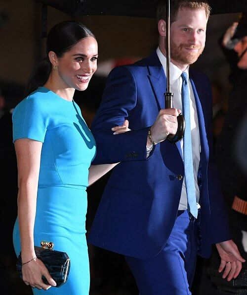 Meghan Markle wore Victoria Beckham pencil midi dress. Meghan, Duchess of Sussex and Prince Harry, Duke of Sussex