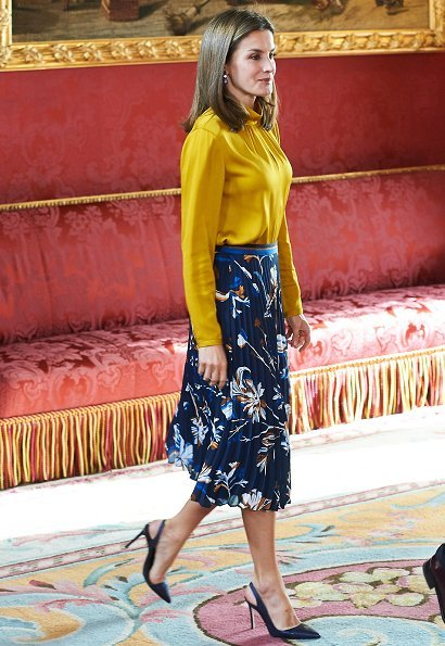 Queen Letizia wore HUGO BOSS Viplisa printed Skirt Magrit shoes and Hugo Boss yellow blouse