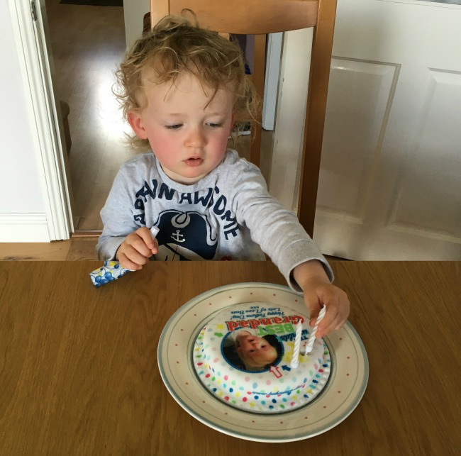 toddler putting candle on cake. The best Grandad Happy fathers day lots of love Bear xxx