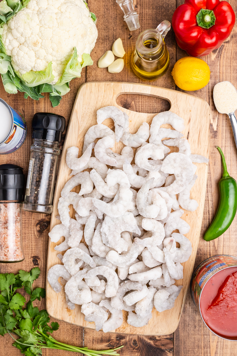 Overhead photo of the ingredients needed to make Keto Brazilian Shrimp Stew on a wooden table.