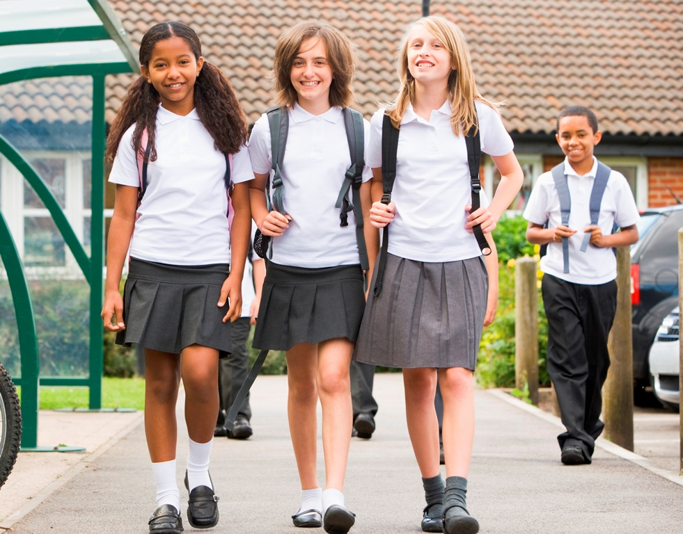 NAMC Montessori circle of inclusion: personalized instruction scientific observation and individual readiness. Three school girls walking.