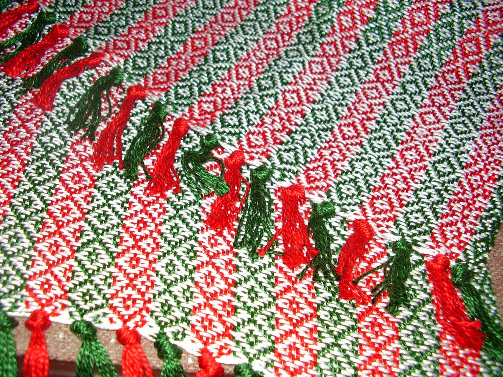 Red, green and white table runner in Finnish Birdseye pattern.