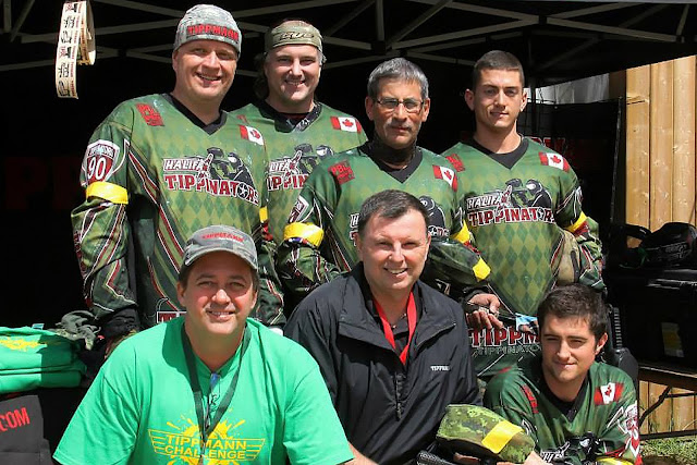 Tippinators pose for a photo with the movers and shakers from Tippmann Sports