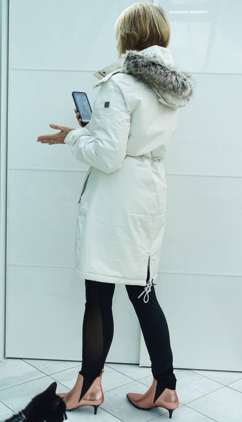 Rear view of the Zaneck parka from the North Face worn by over 50s style blogger Is This Mutton with black leggings and rose gold ankle boots