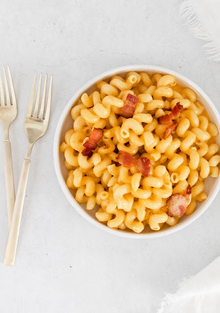 Instant Pot Bacon Macaroni and Cheese In a bowl with two forks