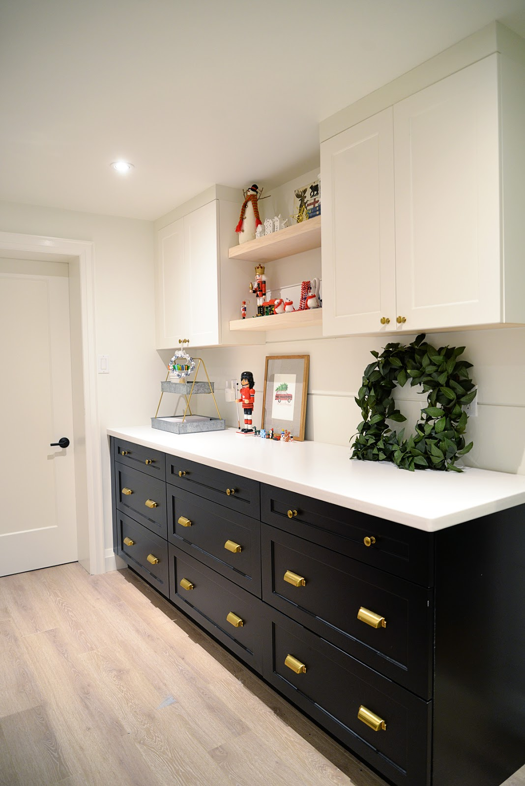 black and white cabinetry, a craft room decorated for Christmas