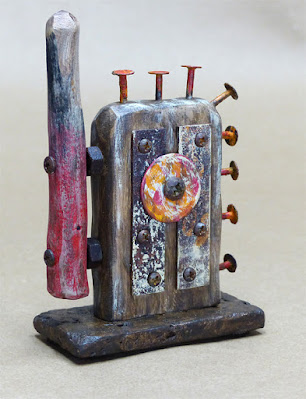 small wood sculpture with found object