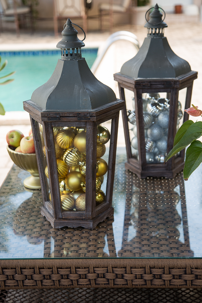 lanterns filled with christmas ornaments