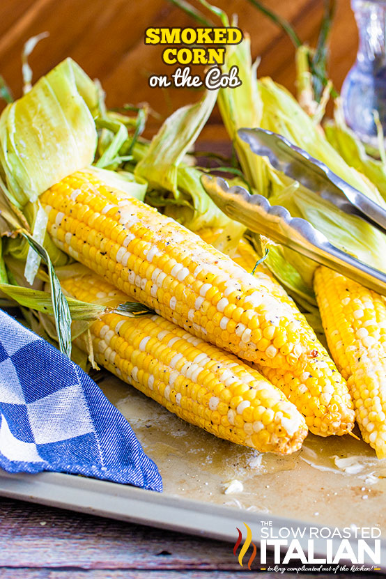 Smoked Corn on the Cob buttered and peppered on a tray