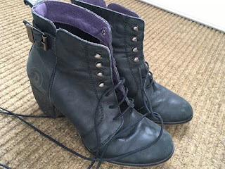 pair of black ladies lace ups with 1.5 inch heels and round laces.