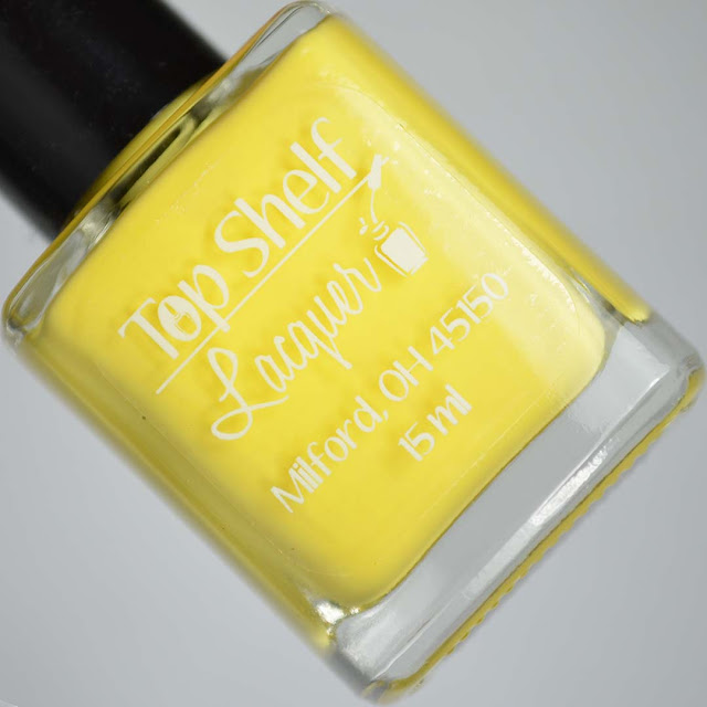 yellow nail polish in a bottle