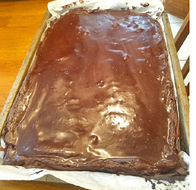 this is a sheet cake dark chocolate fudge cake made with cake mix and brownie mix also topped with dark chocolate frosting