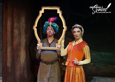Eric Fagan, the magic mirror, is standing next to the evil Queen, Kristin Shirilla.