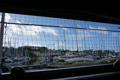 View out of hatch with blue sky and marina