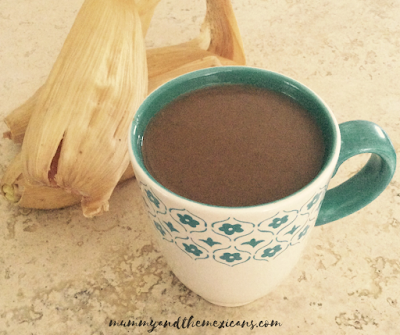 Warming Drinks For Winter In Mexico - Champurrado - Image Shows A Cup Of Champurrado With Tamales Behind