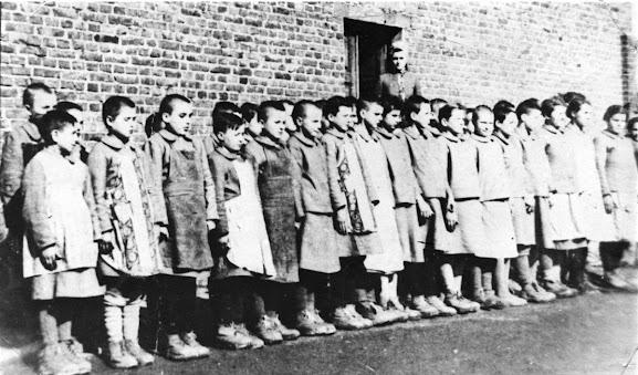 Germany Nazi Poland abuse children slave labour eugenics war crimes genocide