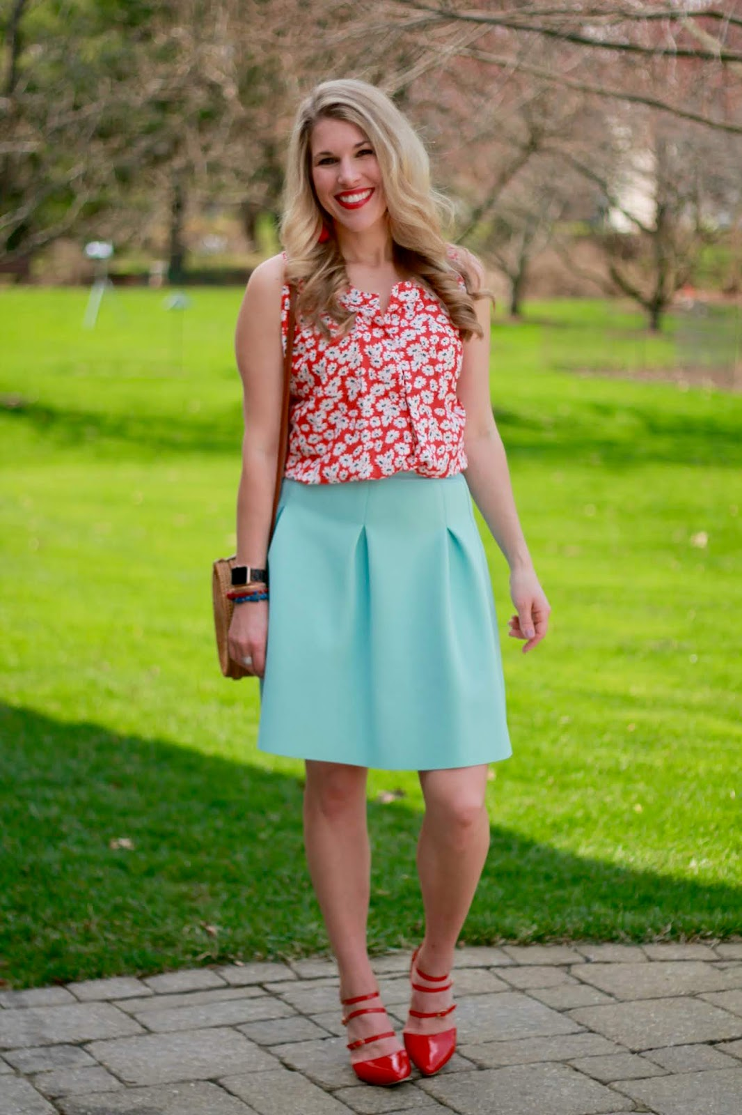 spring skirt outfit, spring work outfit, light blue skirt, red heels, straw circle bag, red floral blouse