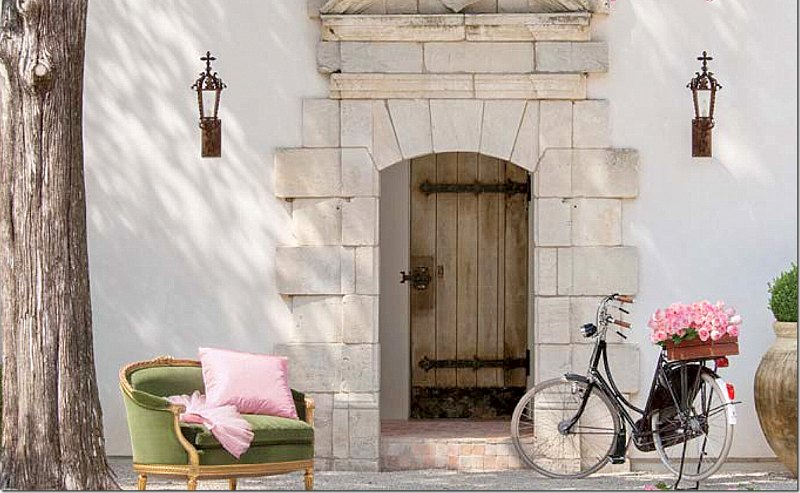 French chateau exterior with bicycle in front on cover of Milieu magazine