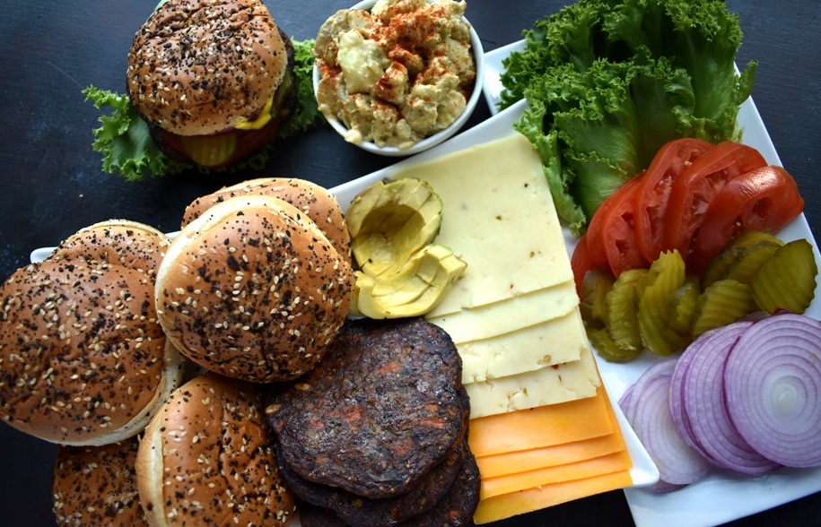 Vegetarian Burger Bar has all your favorite burger toppings including tomato, lettuce, onion, pickles, cheese, avocado, veggie burgers and more for easy entertaining that everyone will love! www.nutritionistreviews.com