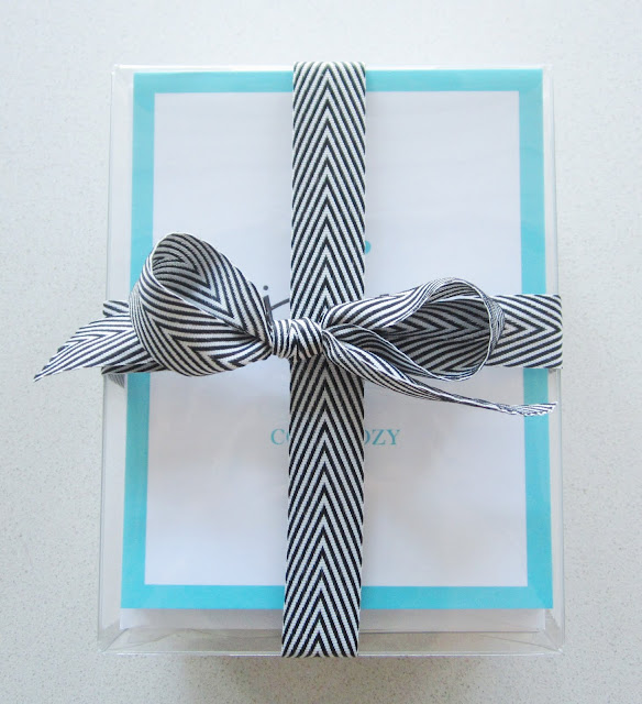 COCOCOZY holiday stationery wrapped in a black and white ribbon