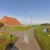Tweewieks Lagerwey windmolen tegen de grond