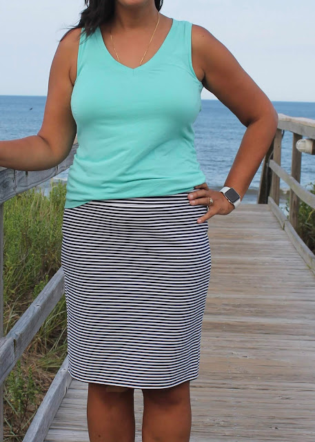 DIY striped knit skirt and v-neck tank top made from the Blank Slate Abrazo Tee pattern, modeled on the beach.