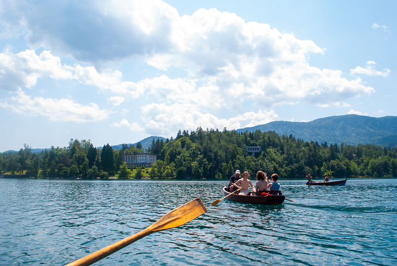 boat rowing and landscape of lake bled in slovenia