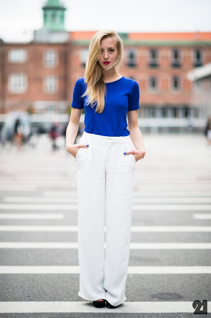 blue shirt and white pants