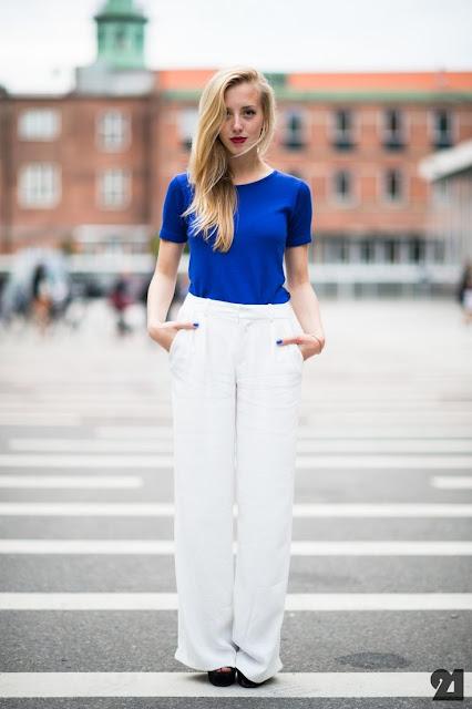 blue shirt and white pants