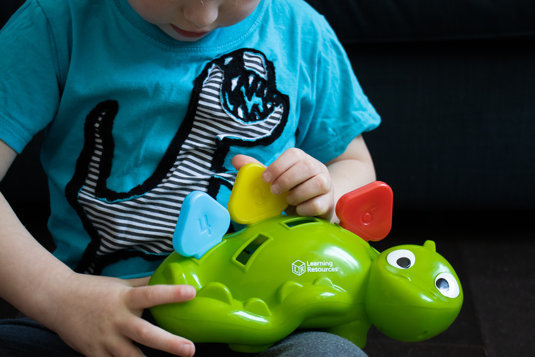 A preschooler learning numbers and colours with a review of Learning Resources Steggy The Fine Motor Dino