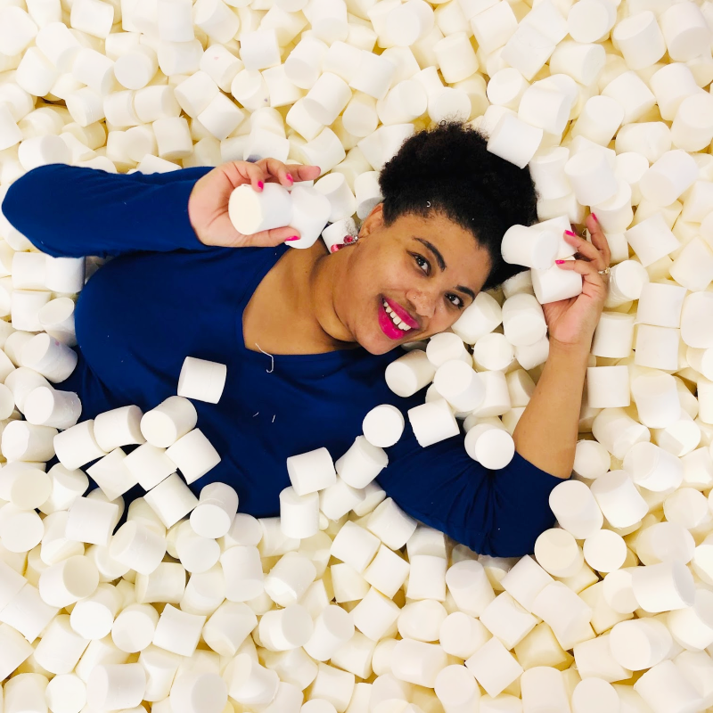 a black lady in a marshmallow pit