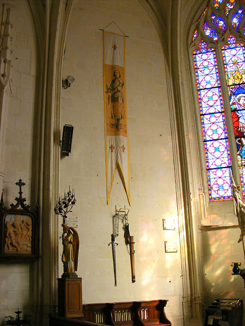 Banner and replica sword of Joan of Arc in the church of Sainte Catherine de Fierbois. Indre et Loire, France. Photo by Loire Valley Time Travel.