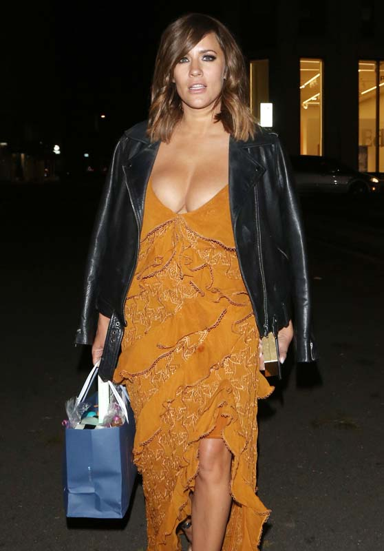 TV Presenter Caroline Flack sexy look top exposing an ...