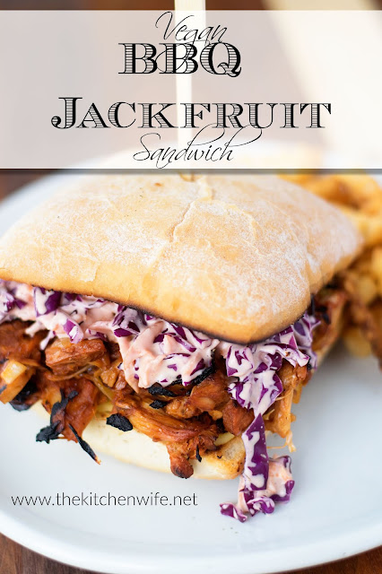 The finished vegan bbq jackfruit sandwiches with some coleslaw on top and fries to the side.