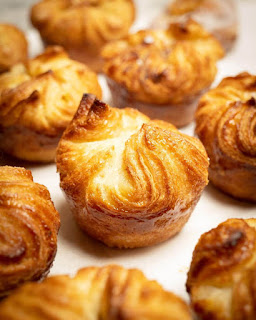 """Kouign-amann, the name comes from the Breton language words for cake """"Kouign"""" and butter """"Amann"""". If you love a good buttery croissant covered with a slightly-caramelized sugar crust, Kouign-amann will be your favorite Viennoserie."""
