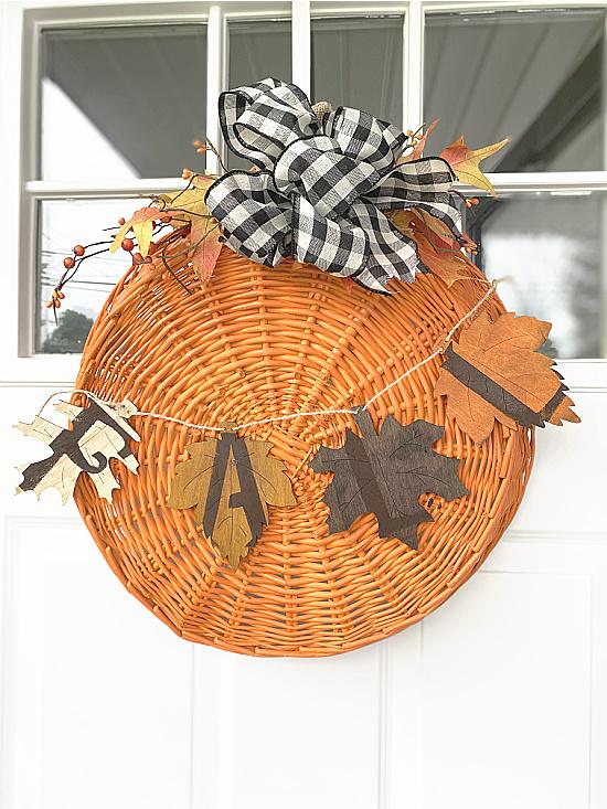 fall pumpkin decoration on front door