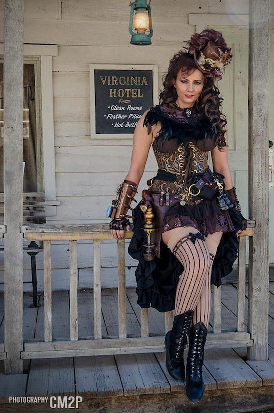 Woman dressed in wild west steampunk clothing as a sexy saloon girl. Corset, skirt, top hat, boots, gun, striped stockings, lace gloves, leather bracer, etc.) Women's steampunk fashion clothing and costumes