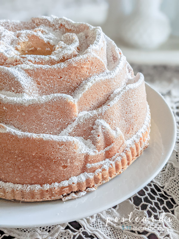 bundt cake made with a rose-shaped pan and sprinkled with powdered sugar