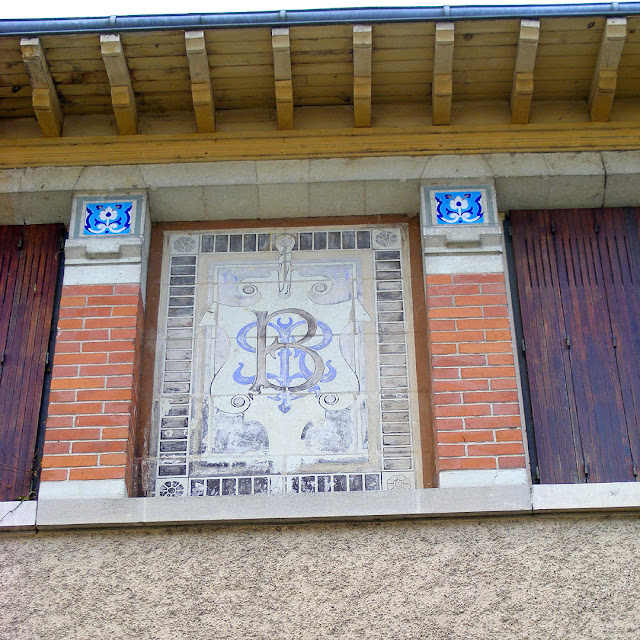 Monogram on the side of Villa Caroline, Les Ormes, Vienne, France. Photo by Loire Valley Time Travel.