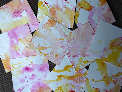 paper splashed with watercolor