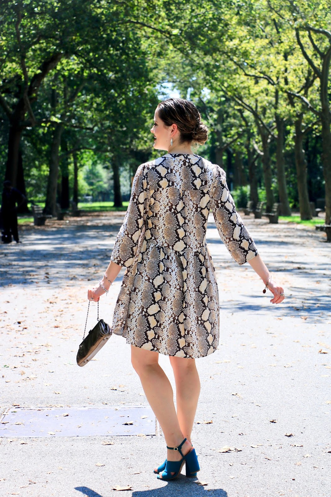 Nyc fashion blogger Kathleen Harper wearing the snake print trend in 2019.